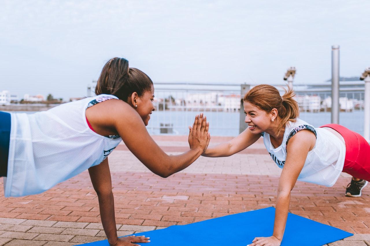 Two happy women exercises
